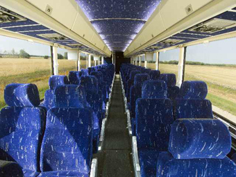 Interior view from the isle of Coach Tours motorcoach bus charter with clean bus seats