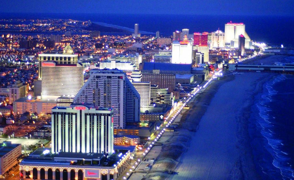 Spectacular view of Atlantic City casino lights and shore line at dusk.