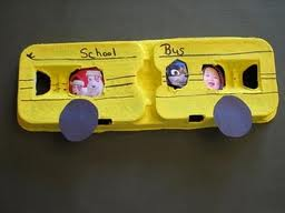School bus made out of a yellow egg carton.