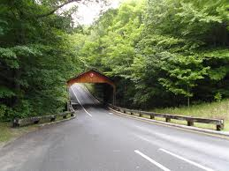 Covered bridge on beautiful roadway.