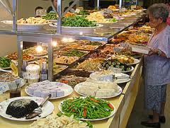 Food buffet with a wide variety of cuisine.