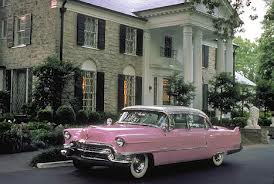 Elvis presley's pink Caddilac parked in front of Graceland in Memphis Tennessee.