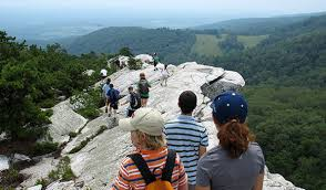 A group exploring the mountain cliffs during a family reunion at the Mohonk Preserve in Upstate, New York.