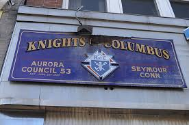 The rectangular Building plaque for Knights of Columbus in Seymore, Ct. is blue with gold lettering and has the logo in the middle.
