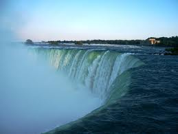 A close up of the mighty Niagara Falls with water splashing creating a vibrant mist in the air.