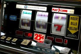 Casino slot machines with numbers spinning.