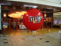 A hugh red M&M on display at NYC's Time Square M&M World.