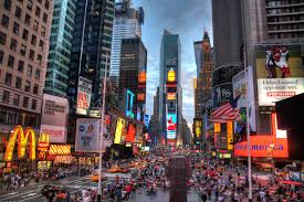 The colorful street view of New York City's Times Square, traffic, buildings and lights.