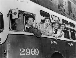 Ralph Kramden of the Honeymooner's behind the wheel of the city bus with Alice, Norton & Trixie all posing out the windows.