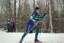 Women skier in blue ski suit hitting the trails on a North East ski slope.