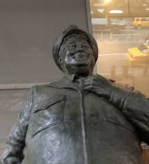 Statue tribute to bus driver Ralph Kramden of Honeymooner's television fame.