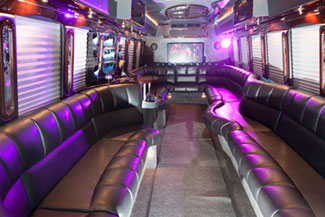 Purple deco side seating Interior of a charter bus that is available for wedding transportation.