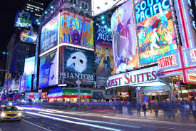 Broadway in NYC with theaters, restaurants & hotels.